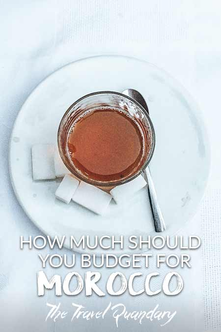 A glass of mint tea and sugar cubes - cost of travelling in Morocco