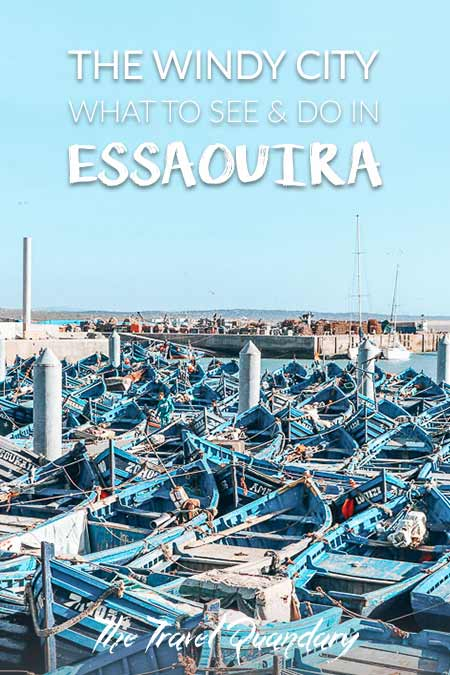 Blue fishing boats sit in the Port of Essaouira, Morocco