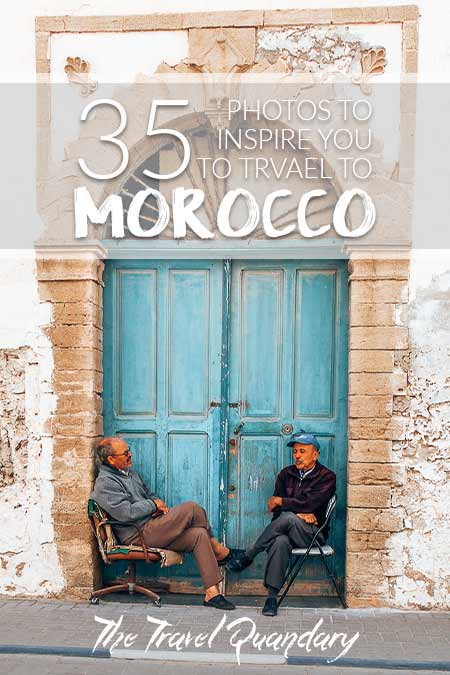 Pin Photo: Morocco Travel Photography | 2 men sit in front of a blue door in Essaouira