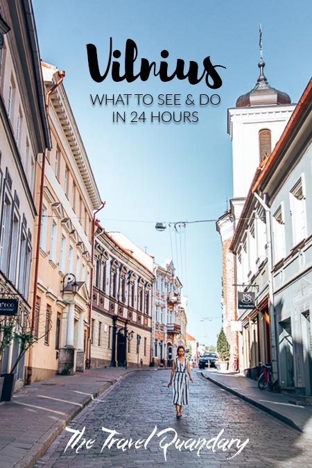 A woman strolls down a street in Vilnius, Lithuania