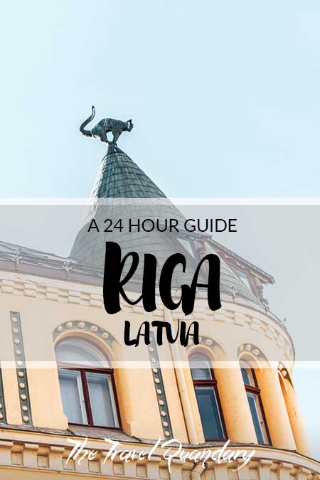 Pin to Pinterest: One of the cats atop the Cat House | one day itinerary Riga