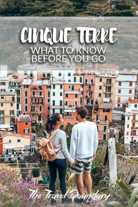 Pin to Pinterest: A couple hold hands overlooking Manarola, Cinque Terre