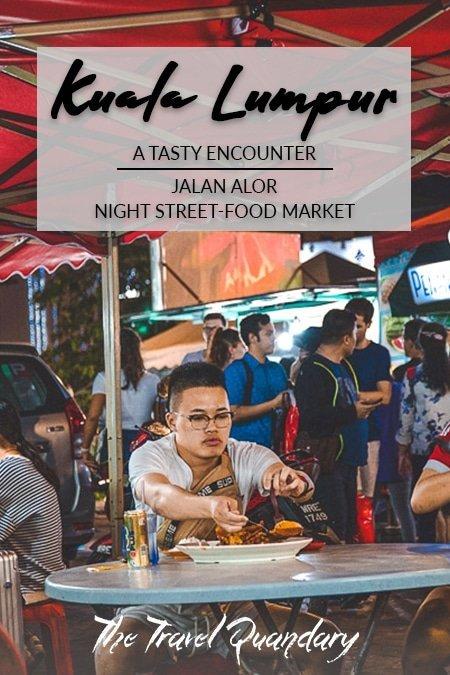 Pin to Pinterest: A man dishes his food seated at Wong Ah Wah at Jalan Alor Street Food Market