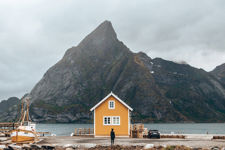 Jasmine stands in front of the famed yellow house in the Lofoten Islands, Norway