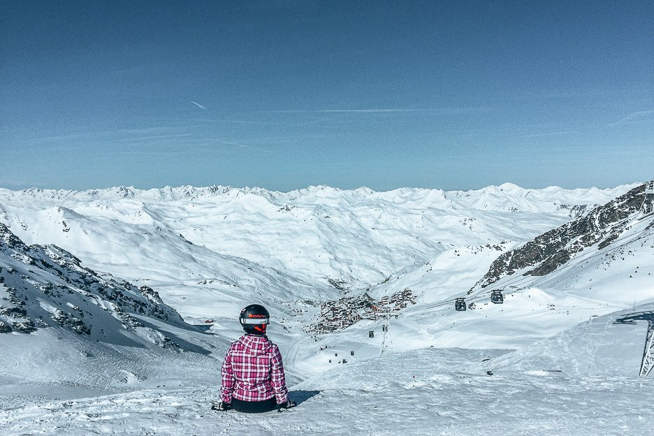 Jasmine sits on the top of a ski run in Val Thorens, France