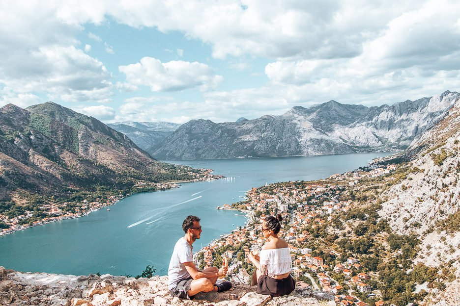 Sitting on the edge of the fortress eating sandwiches overlooking the Bay of Kotor, Montenegro - 12 Great Date Ideas