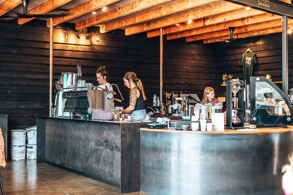 Two female baristas working at Black Sheep Coffee, coffee in Brisbane southside