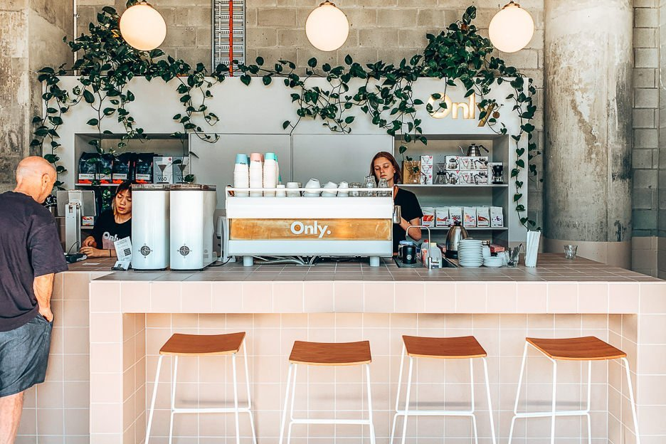 Baristas serving specialty coffee at Only Specialty Coffee, Brisbane CBD