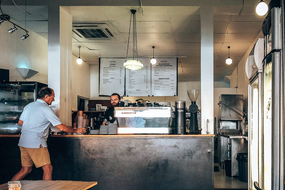 A barista serves a customer at Blackstar Coffee Roasters, Brisbane Coffee Guide