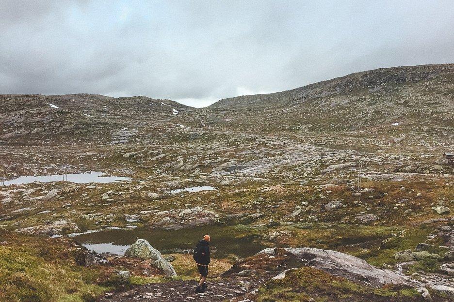 Bevan hiking amongst rugged landscapes - Trolltunga, Norway