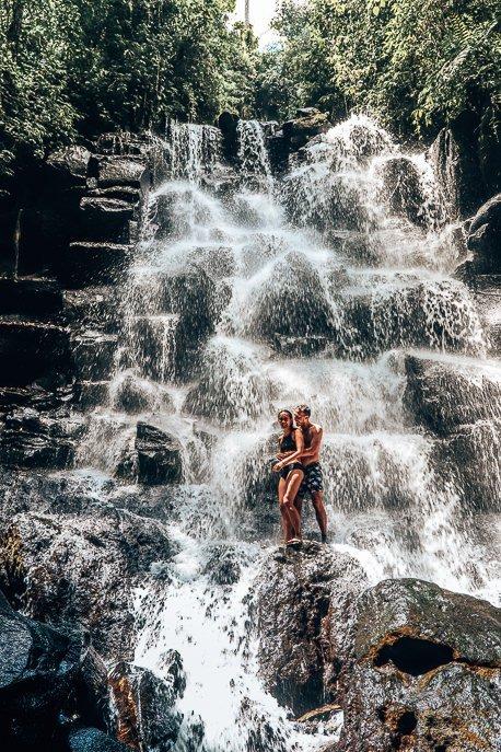 Jasmine and Bevan standing under Kanto Lampo waterfall, Bali Gallery