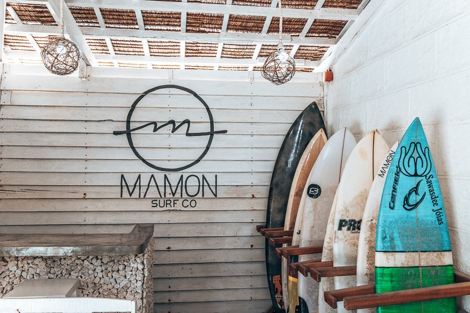 A row of surfboards lined up for rental at Mamon Surf Shop, Siargao