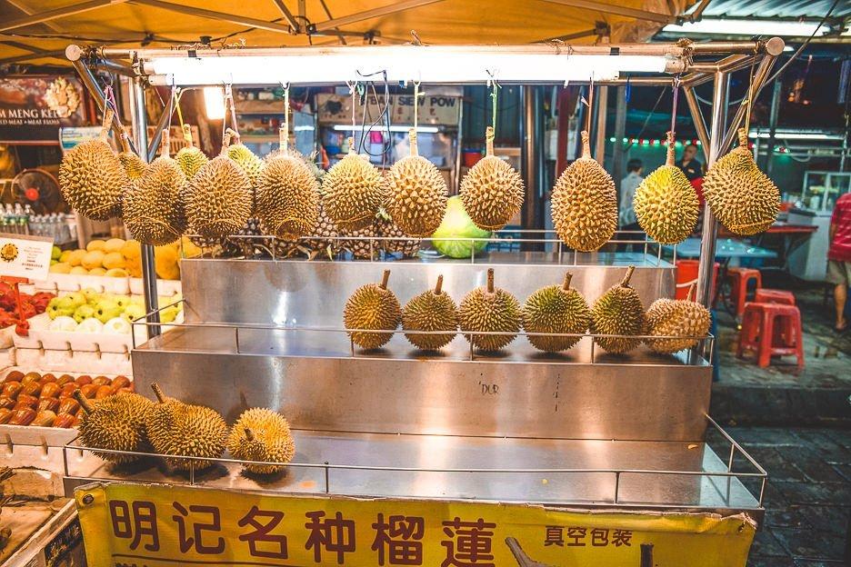 Hanging spiky durian fruit at Jalan Alor Street Food Market, Kuala Lumpur