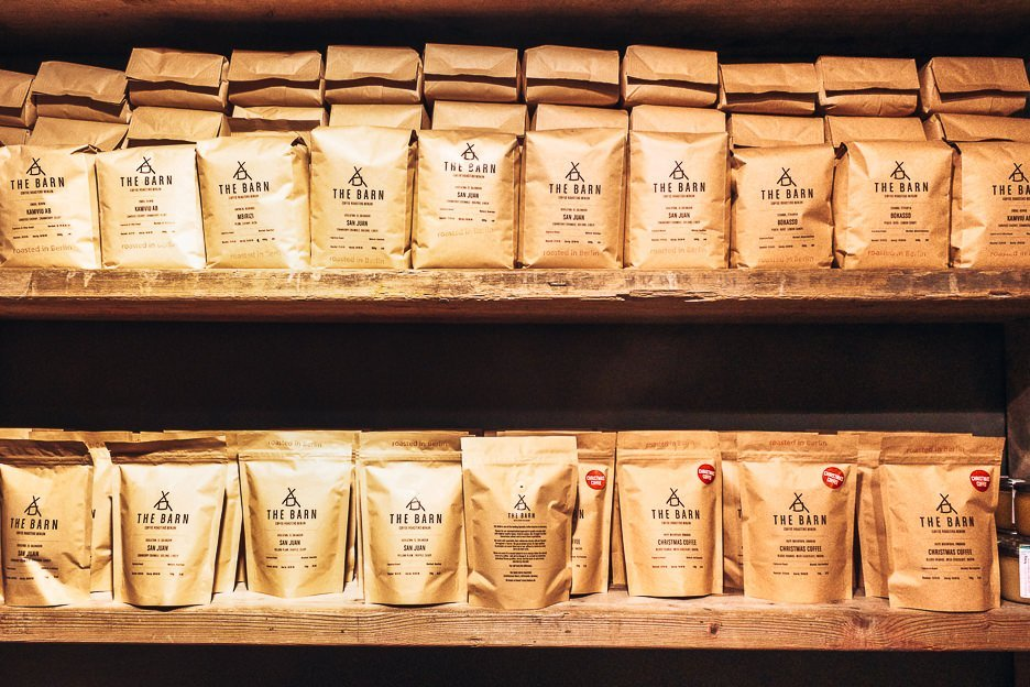 Coffee beans for sale on two shelves in The Barn, Berlin Germany