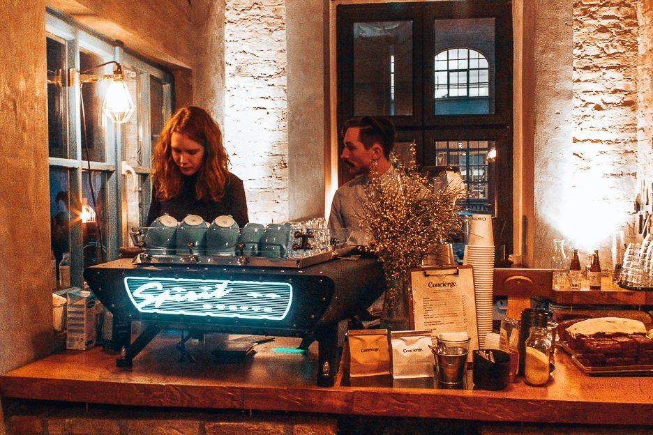 Two baristas preparing espresso coffees inside Concierge Coffee - some of the best coffee in Europe