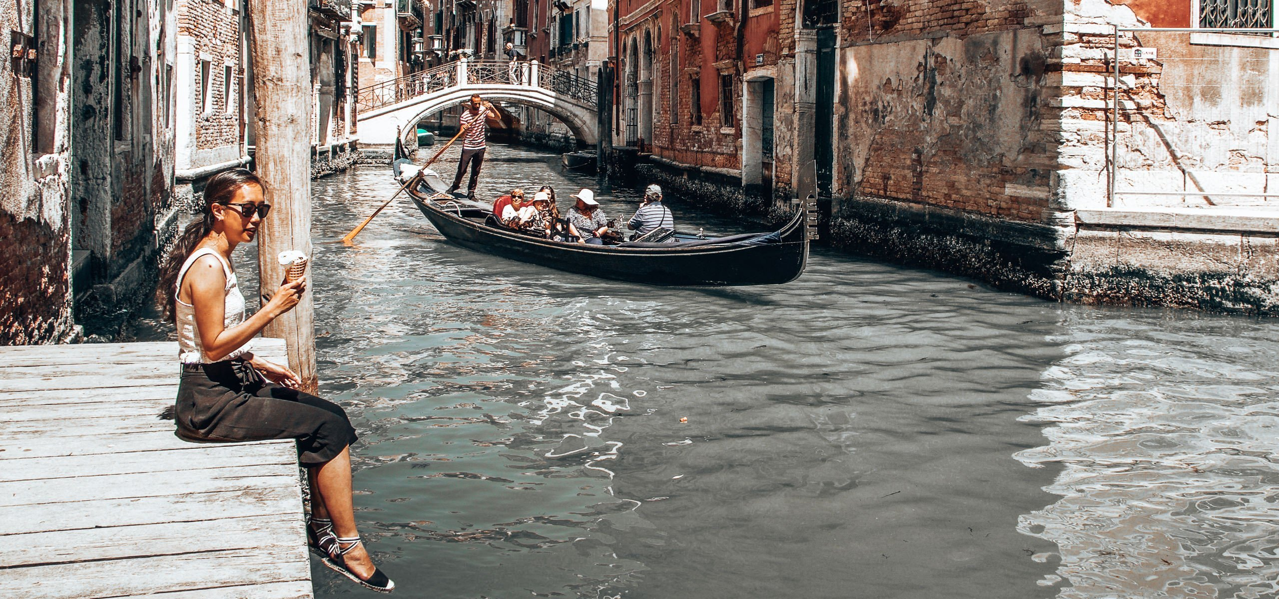 Best Things To Eat In Europe | Sitting on a wooden pier eating gelato overlooking a canal in Venice, Italy