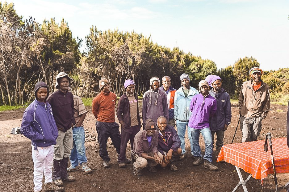 Tanzanian men work as guides and porters supporting hikers up and down Mt Kilimanjaro