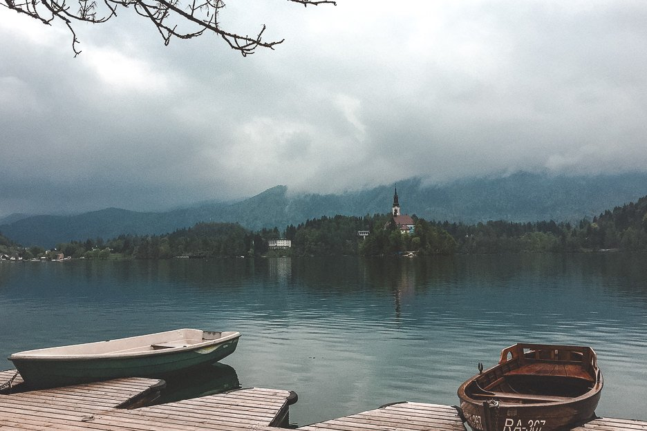 Rowboats sit in the harbour of Lake Bled, Slovenia