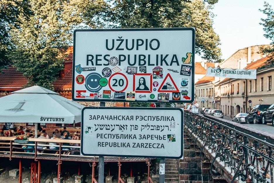 The entrance to Uzupio Respublika covered in stickers, Vilnius