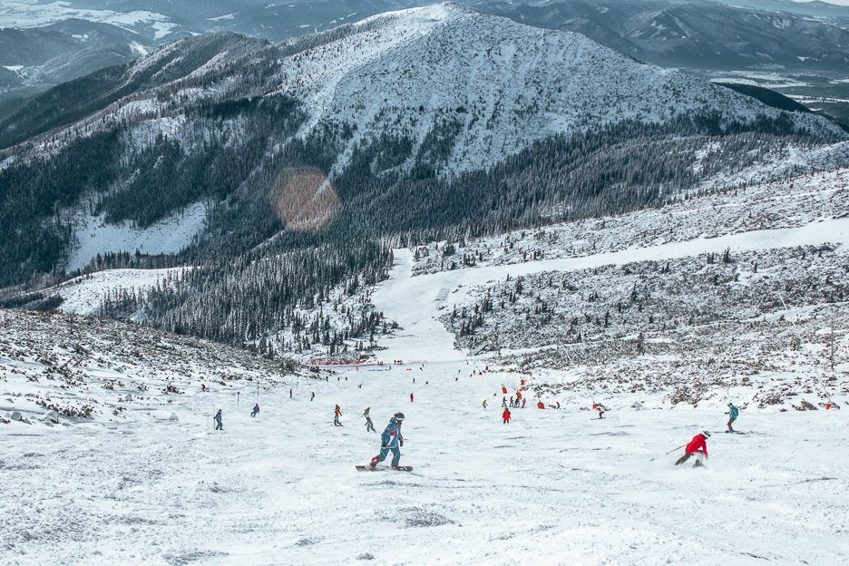 Skiiers and snowboarders hit the slopes at Jasna Nizke Tatry