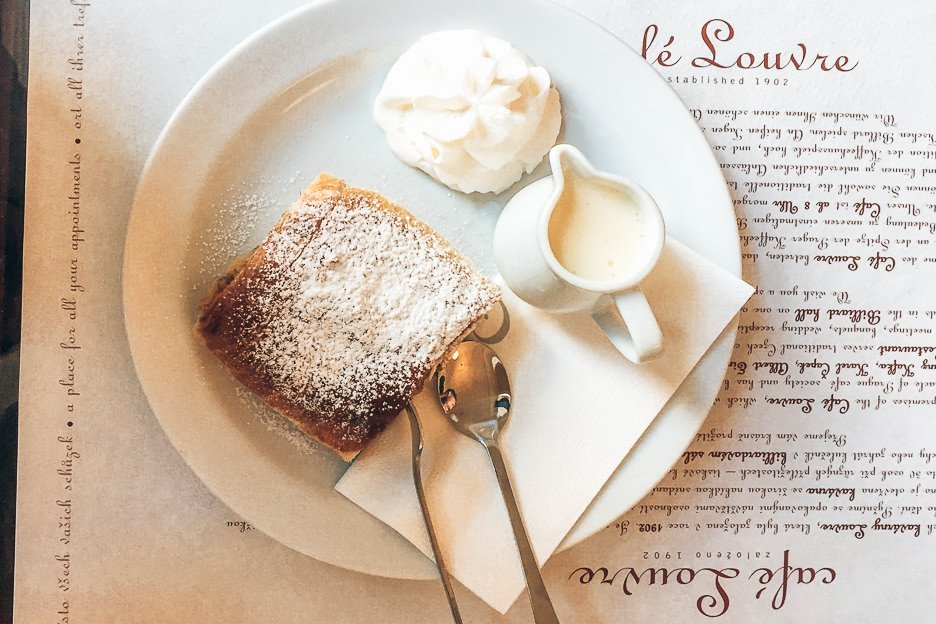Apple strudel and cream at Cafe Louvre, Prague City Guide