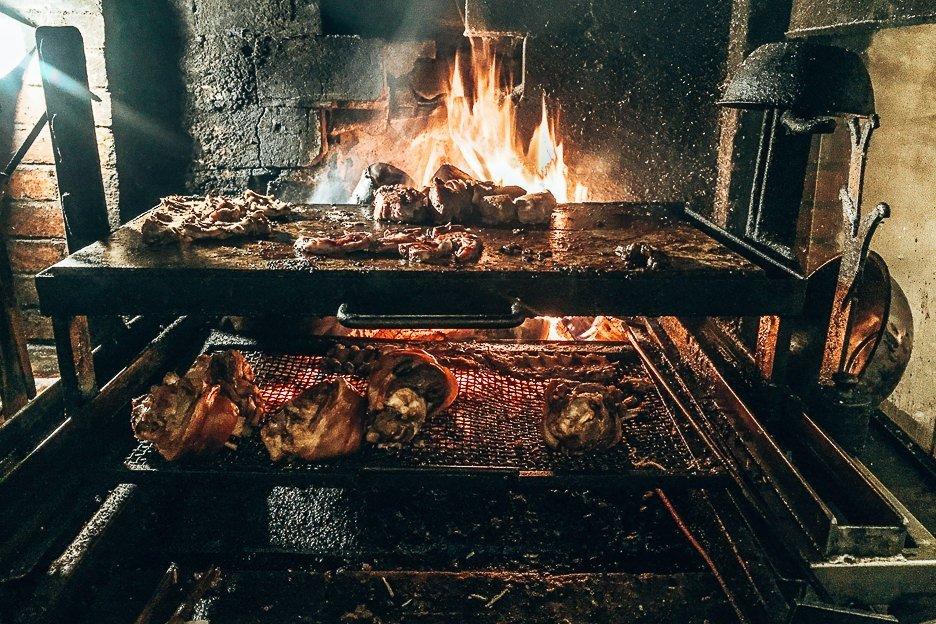 The open fire grill cooking meat at Krčma v Šatlavské ulici, Cesky Krumlov