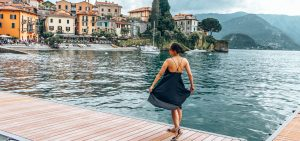 Twirling in a black dress on a pontoon at Varenna, Lake Como, Italy