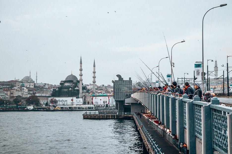 Fisherman wait patiently on Galata Bridge - Istanbul City Guide