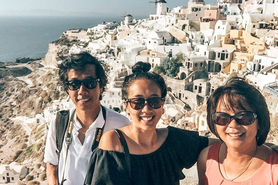 Jasmine with her parents in Oia, Santorini, Greece