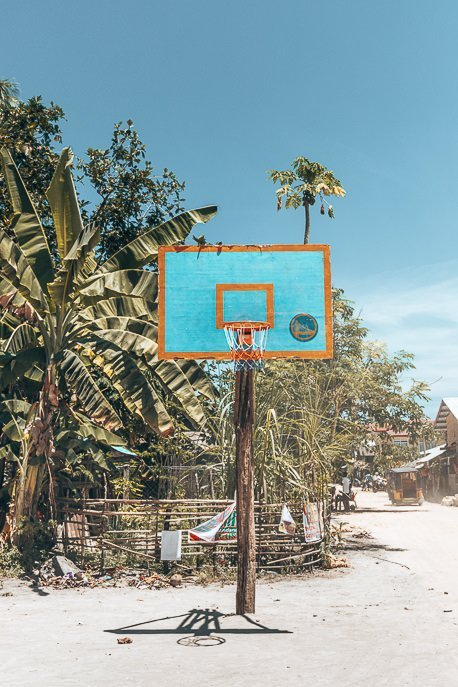 A lone basketball hoop on a sandy court, Siargao