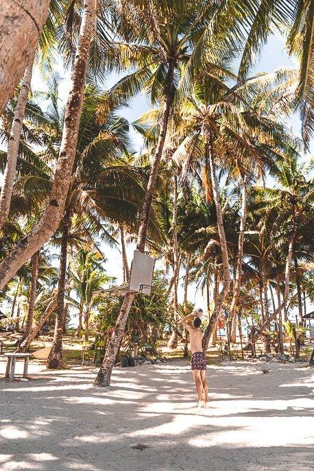 Playing basketball among the palm trees on Guyum Island, Siargao