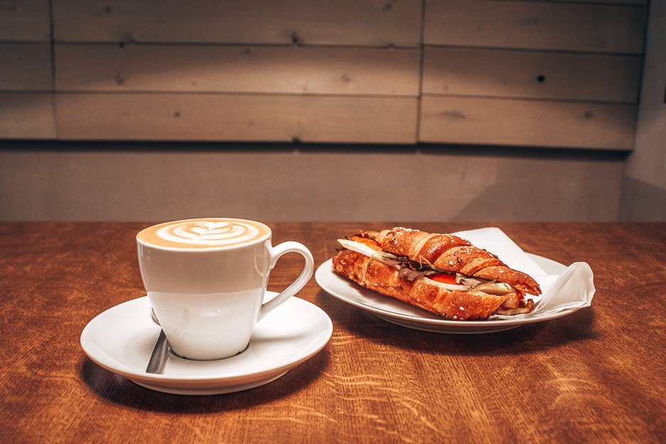Enjoying a coffee and pastry at Mantra Specialty Coffee Minibar, Budapest Hungary