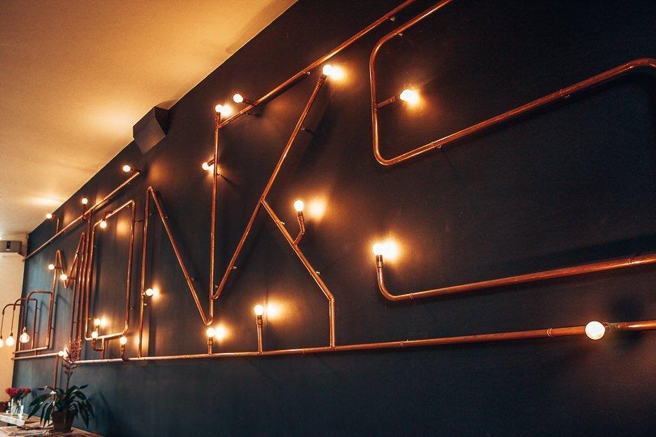 Lightbulb mural inside Monks Coffee Roasters