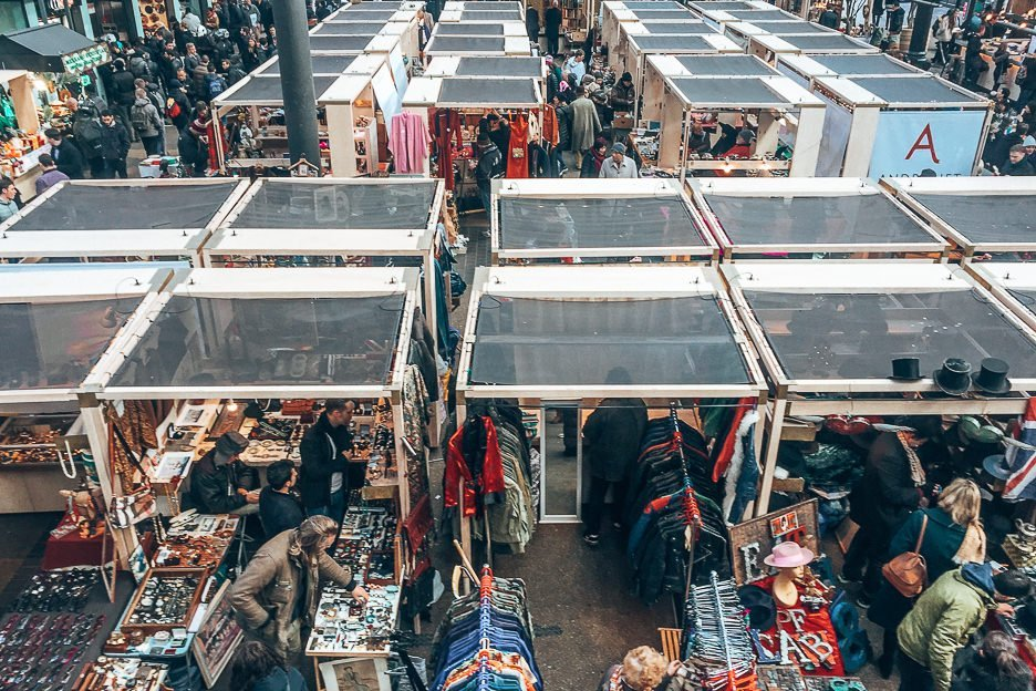 Indoor stalls selling knicknacks at Old Spitalfields Market, east London