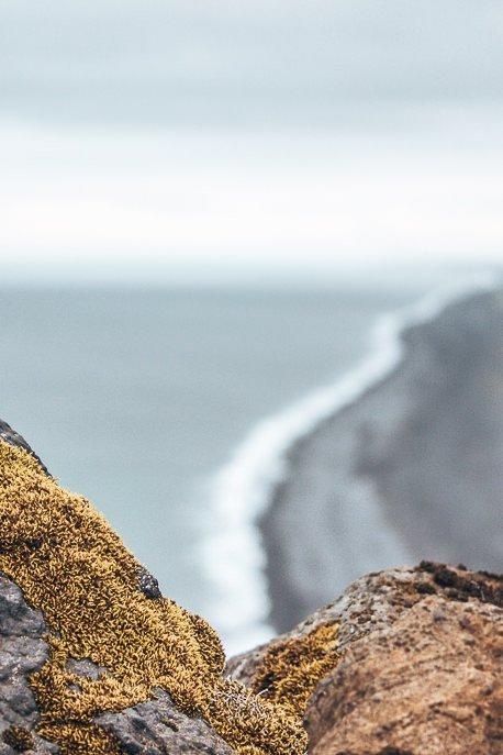 Peering through the rocks at the black beaches, Iceland