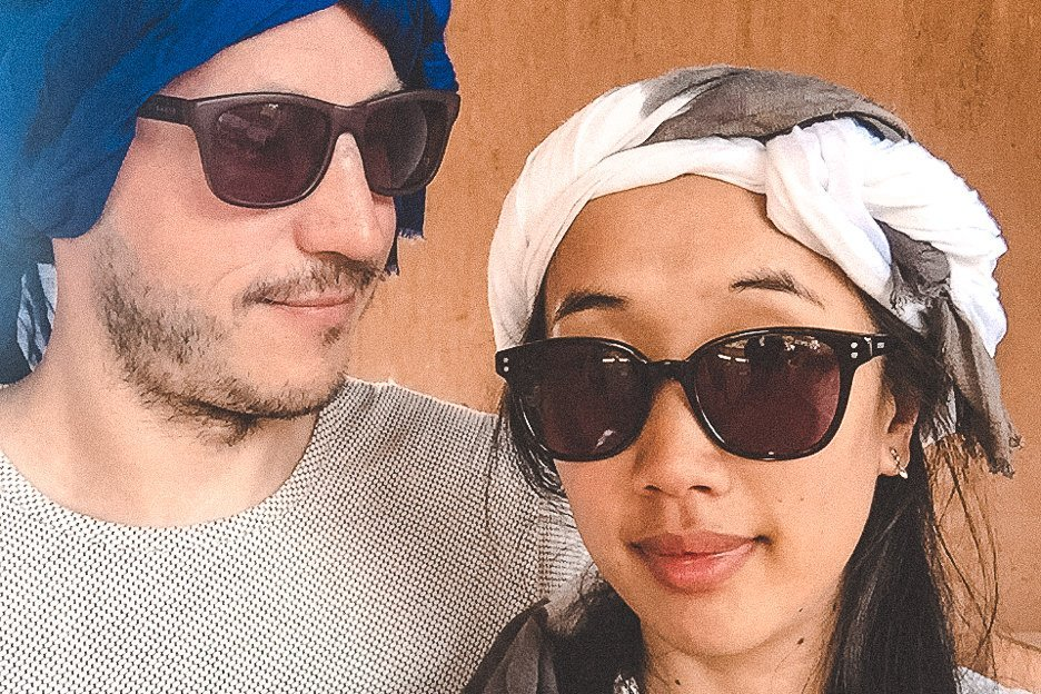 Bevan and Jasmine wearing Berber scarves before camel riding in Morocco