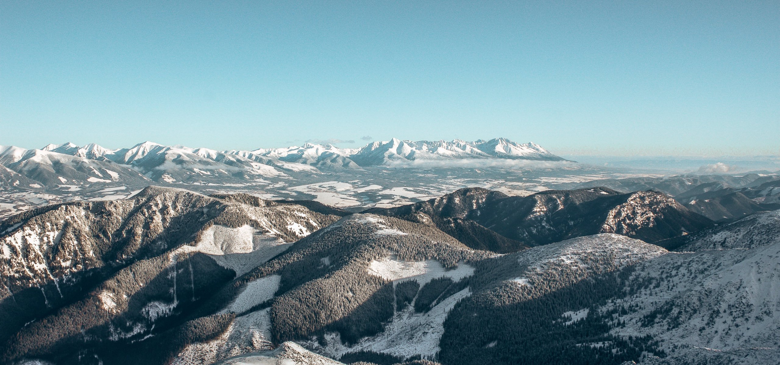 The rolling snow dusted mountain tops in Slovakia