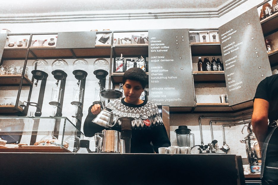 Baristra preparing Aeropress at Coffee Manifesto, Coffee in Istanbul