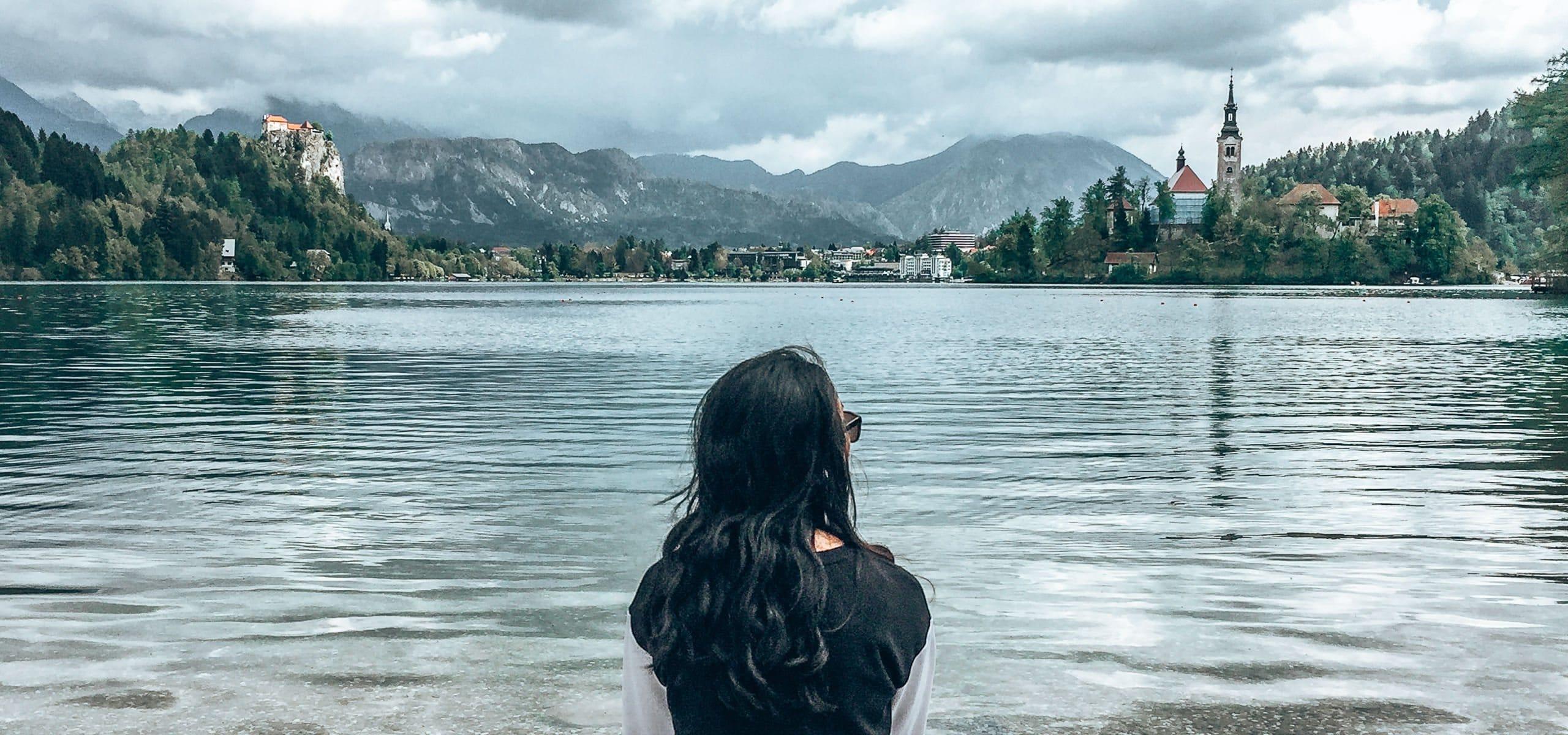 Sitting on the edge of Lake Bled, Slovenia