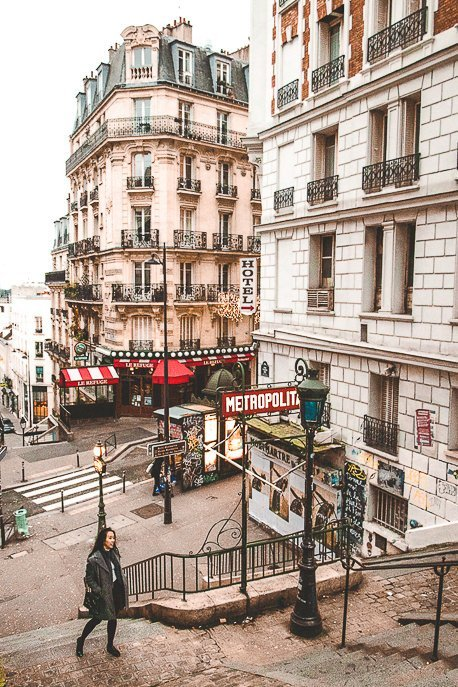 Jasmine standing next to a metro station in Montmartre in Paris, France