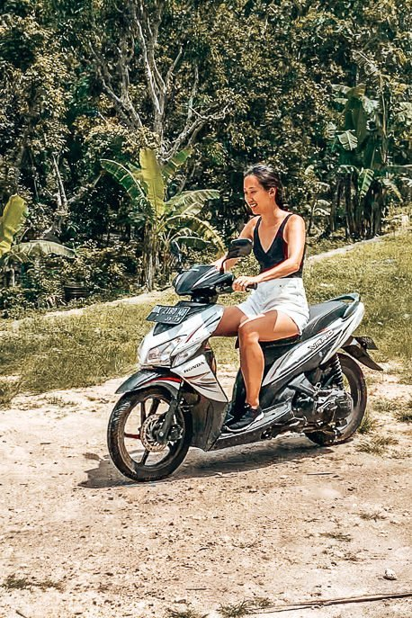 Jasmine riding a scooter in Nusa Penida | The Travel Quandary