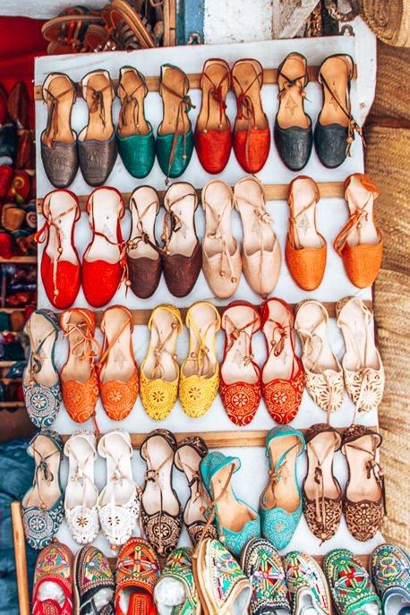 Shoe shopping in the souks of Essaouira, Morocco