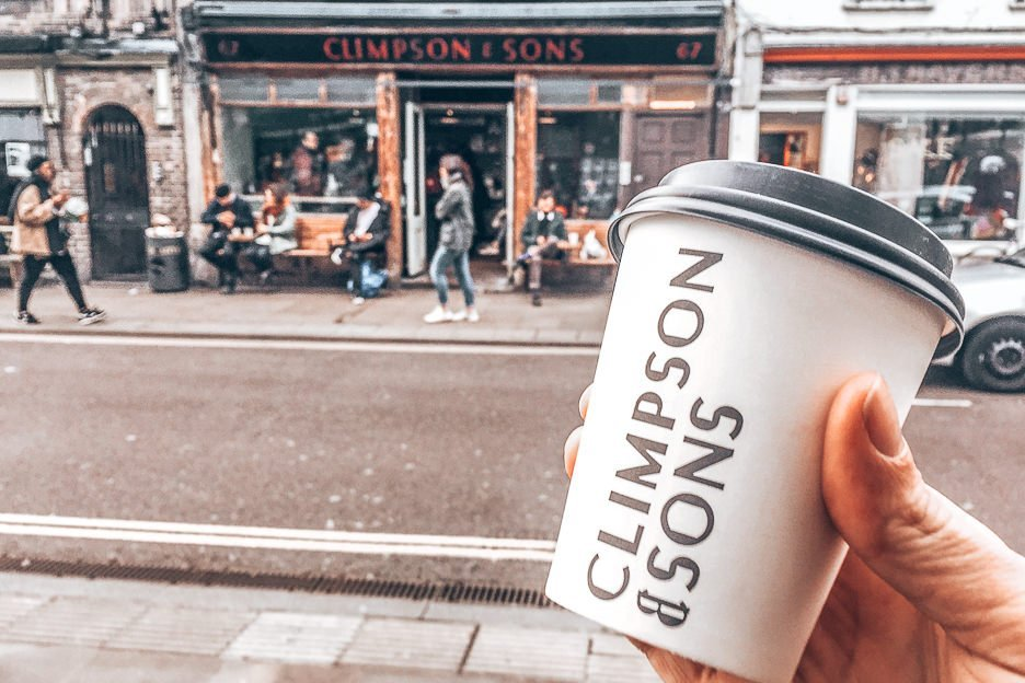 A takeaway coffee cup outside the Climpson & Sons flagship cafe in East London, England