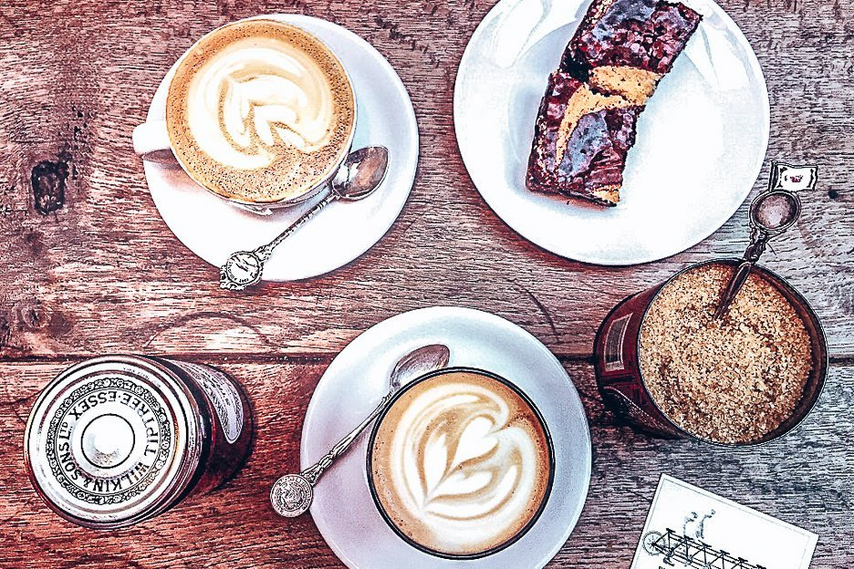 Two flat whites and a chocolate and caramel brownie from TAP Coffee in London, United Kingdom