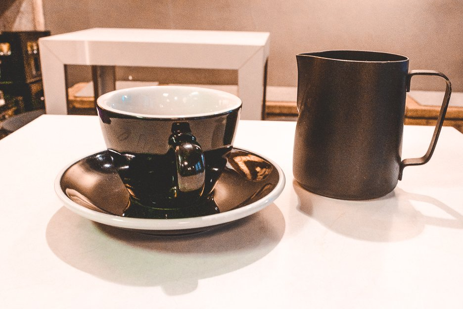 Filter coffee in black cup and saucer at The Barn, Berlin Germany