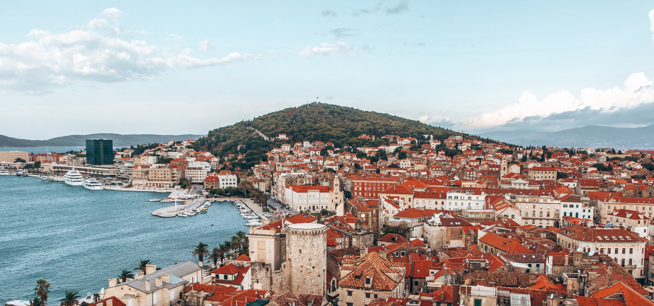 Birds eye view of the red roofs of Split and the harbour in Split, Croatia