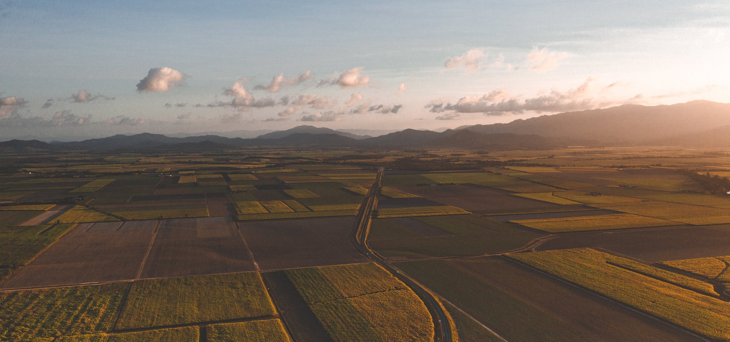 Aerial view of farm lands at sunset in tropical North Queensland