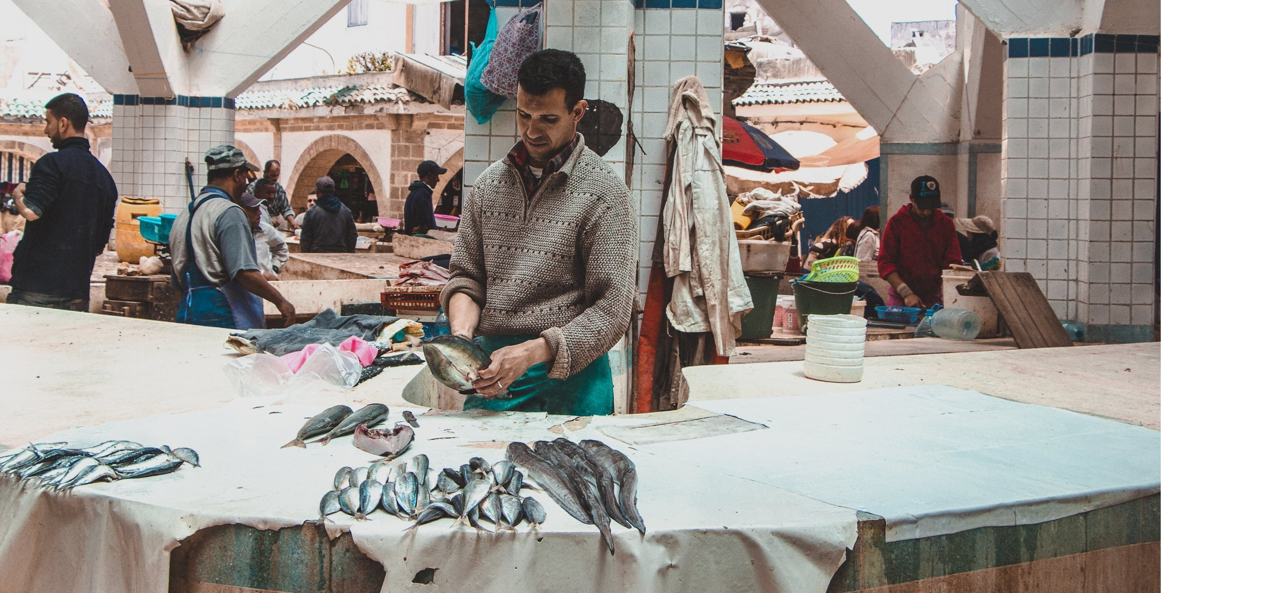 A man cleans fish at the Marche aux Poissons in Essaouira, Morocco |Beyond the Tagine: 11 Foods and Drinks of Morocco