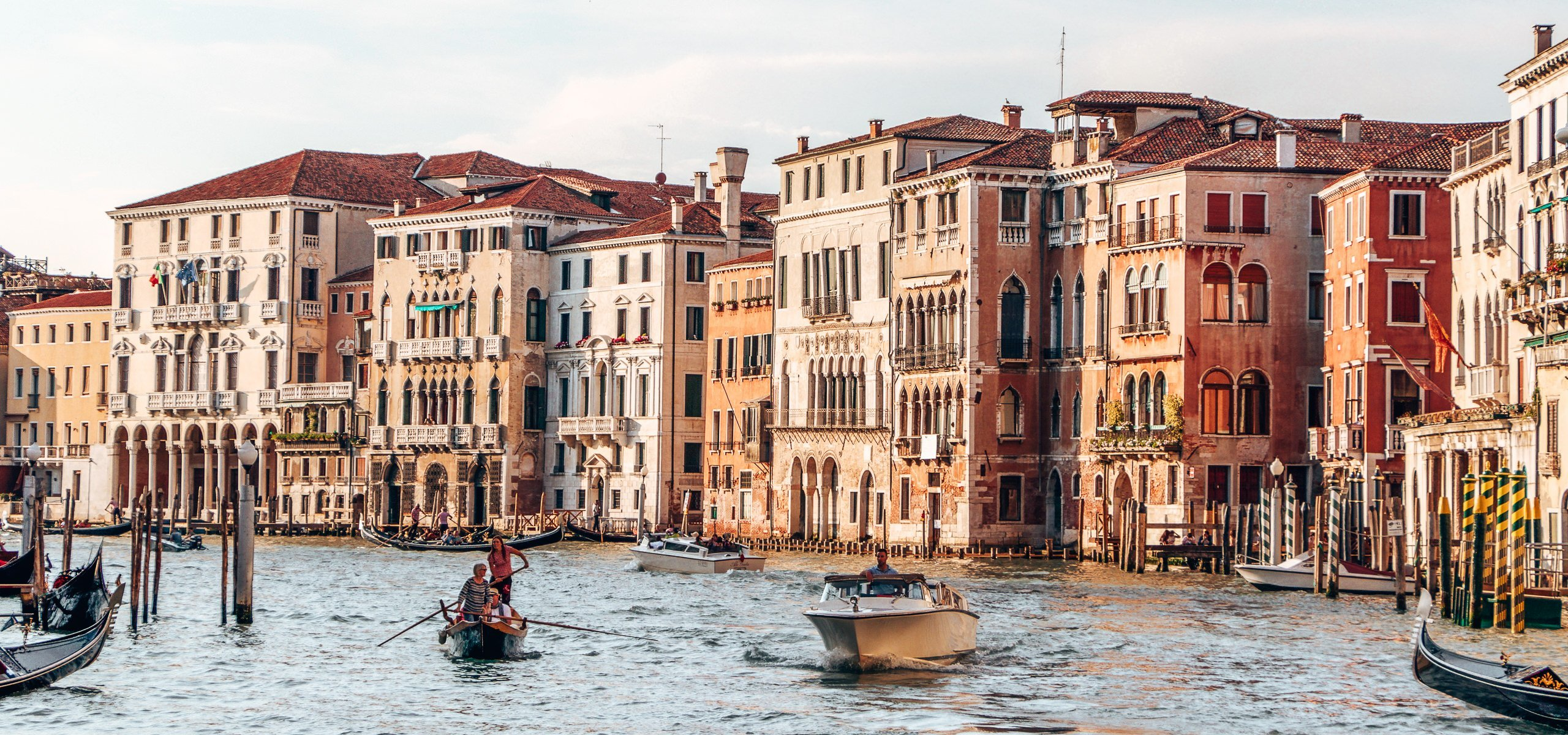 Boats and gondolas share the canals in Venice, Italy