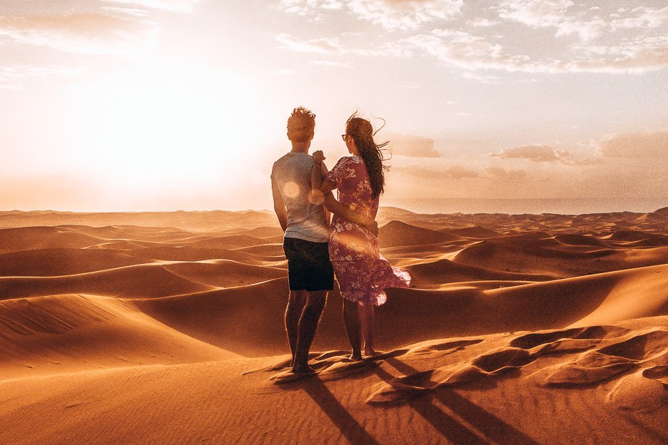 The Travel Quandary Camera Kit Bag | a couple watching sunrise over the dunes of the Sahara Desert, Morocco
